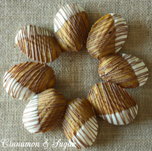 Pumpkin Spiced Madeleines are cake-like cookies dipped in white chocolate & drizzled with chocolate. Elegant enough for guests, the kids will love them too.