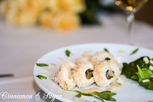 Stuffed Chicken Breast with Lemon-Tarragon Sauce uses crispy pancetta, mild, nutty Fontina cheese and vibrant baby spinach for a beautiful, delicious meal. Recipe shared with permission granted by Barbara Ross, author of FOGGED INN.