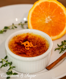 This Orange Cinnamon Crème Brûlée recipe steeps cinnamon, thyme and orange peel in a custard base to add a complex subtlety to this decadently creamy dessert that is crowned with a crunchy bittersweet layer of yumminess. Recipe shared with permission granted by Leslie Budewitz, author of GUILTY AS CINNAMON.