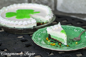 Easy no-bake Triple Layer Pistachio Pie: Oreo crust, fudgy layers of chocolate & crunchy pistachios, topped with creamy layers of pudding & whipped topping.
