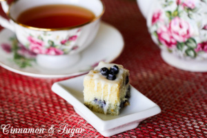 Blueberry Muffin Bars are a light, delicate cake packed full of fresh, juicy blueberries, then topped with a vanilla drizzle, they are perfect for making ahead for any occasion …like breakfast, snack, or dessert!