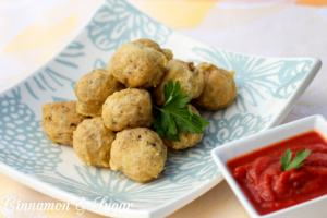 Talia's Deep-Fried Meatballs are delicious golden brown morsels that are perfect appetizers or a casual main course. These meatballs will become a favorite!