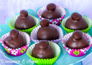 Deep, dark chocolate infused with espresso powder, then topped with a chocolate covered espresso bean, Mocha Truffles give you an incredible jolt of flavor! Recipe shared with permission granted by Kathy Aarons, author of TRUFFLED TO DEATH.