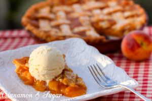 Juicy sweet peaches are laced with brown sugar, cinnamon, and nutmeg then topped with a flaky lattice crust to make the BEST peach pie ever!