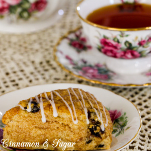 Whiskey and cinnamon simmered raisins infuse these Drunken Raisin Scones with loads of spiced flavor while the flaky, tender pastry will melt in your mouth!