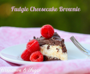 A decadent brownie base and dark chocolate topping encase creamy, rich cheesecake filling making this Fudgie Cheesecake Brownie a chocolate lover's dream!