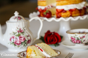 A traditional English dessert, Victoria Sponge Cake is a delicately flavored and textured cake layered with flavorful strawberry jam and rich whipped cream.