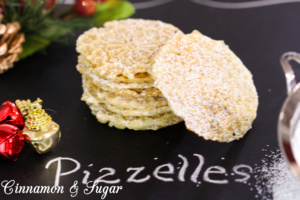Serafina's Pizzelles (Italian Christmas Waffle Cookies) have a delicate flavor and are beautifully lacy with the addition of a dusting of powdered sugar.