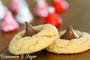 Soft and chewy peanut butter cookies combine with sweet milk chocolate kisses to make everyone's favorite Peanut Butter Blossom Cookies!