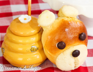 Light, fluffy sweet bread accented with cookie dough for the features, combine to create adorable Teddy Bear Rolls! Perfect for tea parties or picnics!