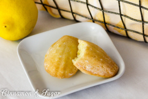 Elegant, cake-like Lemon Glazed Madeleine Cookies are an idea dessert to serve at luncheons or teas and delicious with bubbly Prosecco or a hot cup of tea!