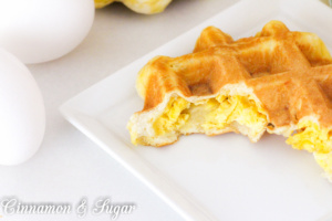 Breakfast made easy: refrigerated biscuits stuffed with cheesy eggs then quickly cooked in a waffle maker. Waffle Biscuits are perfect for on the go!