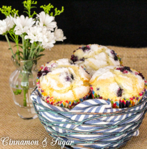 Mrs. Hudson's Tea Room Blueberry Muffins are tender vanilla cakes filled with juicy blueberries and topped with nutmeg-scented sugar for a crunchy contrast.