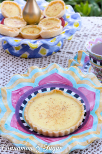 A classic, English Egg Custard Tarts are flaky pastry shells filled with a creamy, rich custard that is delicately flavored with vanilla and nutmeg.