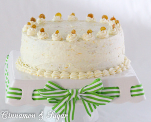 Carrot Cake with Cream Cheese Frosting and Candied Ginger is chock-full of carrots, nuts, spices, and citrus. Tangy cream cheese frosting and candied ginger adorns this cake that is worthy of any special occasion or any reason to splurge and treat yourself to a very delicious dessert!