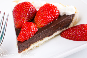 A flaky, buttery crust provides the base for a decadently, rich Chocolate Truffle Tart that is garnished with juicy, red strawberries and sweetened whipped cream. Chocolate and strawberries are the perfect combination to impress your family and friends!
