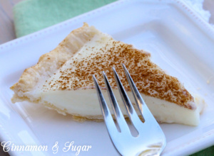 Sugar Cream Pie combines fresh dairy ingredients to create a creamy dessert providing both comfort and indulgence with a warm dusting of cinnamon on top.