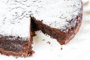 Naturally gluten-free, Flourless Chocolate Cake uses simple ingredients, a couple easy techniques, and voilà, a decadent dessert that will wow your guests!