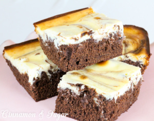 Sadie's Cheesecake Brownies is a moist chocolately base that mix up quickly. Easy, tangy cheesecake tops the brownies and is swirled for a marbling effect.