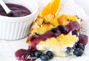 Rich & satisfying with eggs, dairy, and blueberries and topped with a warm blueberry sauce, Baked Blueberry French Toast is a delicious make-ahead dish!