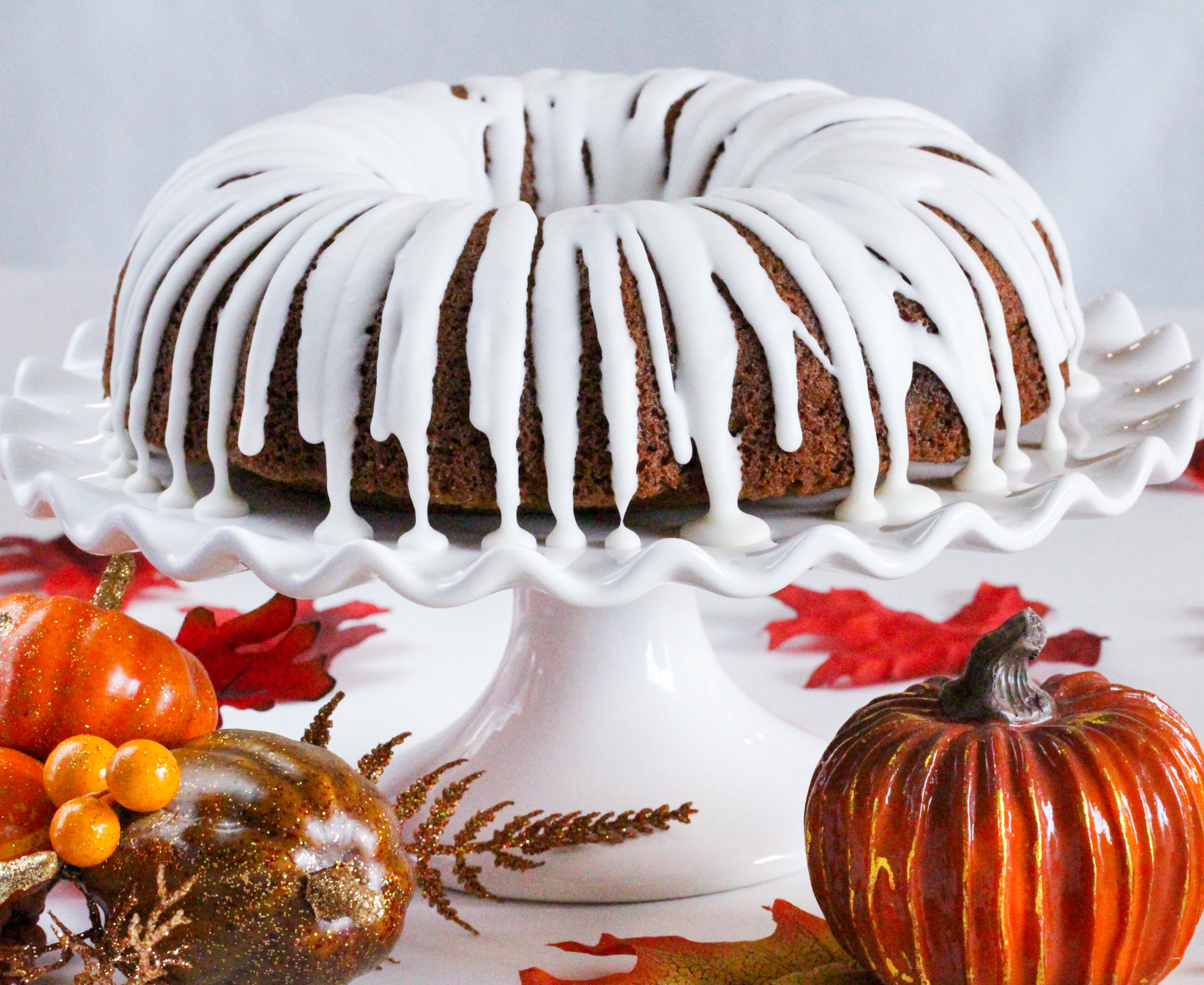 Six spices combine to infuse Chai Spice Cake with delicious flavor. With a generous drizzle of Cream Cheese Glaze, this showstopper will wow your guests! Recipe shared with permission granted by Jenny Kales, author of CALLIE'S KITCHEN MYSTERIES COOKBOOK.