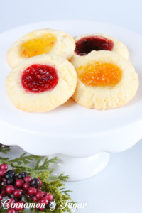 Jewel Brooch Cookies are easy to make with the jewel tones of the jam making these shortbread-style cookies a festive addition to any holiday cookie plate!