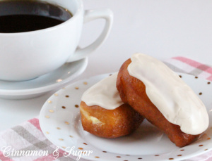 Cream-filled Maple Bars are yeasty deep-fried donuts that are filled with sweet vanilla cream then topped with maple frosting. Perfect with coffee or tea!