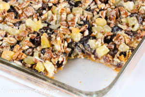 Layers of graham cracker crumbs, coconut, dates, cherries, pineapple, pecans, and sweetened condensed milk mix up in a jiffy to create sweet, chewy Church Basement Funeral Bars!