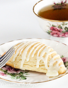 Eggnog Scones are flaky, buttery, and melt-in-your-mouth yummy! Perfect for the holidays or even a special treat no matter what time of year it is! Recipe shared with permission granted by Laura Childs, author of BROKEN BONE CHINA.