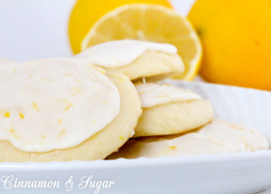 Lemon Ricotta Cookies are super moist lemony, cake-like cookies, thanks to the ricotta cheese while the icing brings an extra bite of tart & sweet flavors. Recipe shared from Debra Sennefelder, author of THE HIDDEN CORPSE.