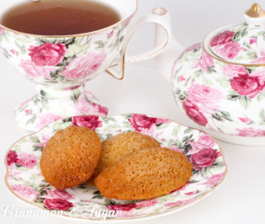Paleo Earl Grey Madeleines are gluten- & dairy-free cake-like cookies. A subtle hint of Earl Gray tea make these perfect for tea-time or a champagne brunch! Recipe shared from cozy mystery, RESTAURANT WEEKS ARE MURDER by Libby Klein.