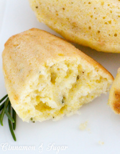 Rosemary Cornmeal Madeleines are an elegant way to serve cornbread. Delicious warmed up with butter, this cornbread features a hint of rosemary and Asiago. Recipe shared with permission granted by Amy Patricia Meade, author of Cookin' the Books.