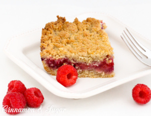 Berry Crumb Bars start with an easy to make dough that serves as both the crust and crumb topping, while a generous amount of juicy berries provide a jammy filling. Recipe shared from cozy mystery SOUTHERN SASS AND KILLER CRAVINGS by Kate Young.