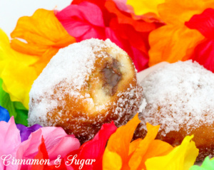 Popular in Hawaii, malasadas are rich with eggs, butter and milk. Deep-fried, then coated with sugar, these pillowy donuts are filled with coconut or chocolate custard. Recipe shared with permission granted by Josi Avari, author of NEST EGG.