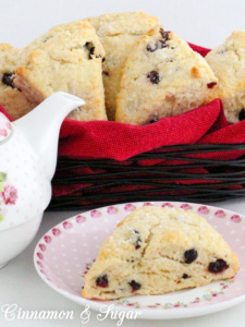 The slightly tart, slightly sweet addition of dried cranberries adds both flavor and texture to these delectable, tender Cranberry Scones.  Recipe shared with permission granted by Lynn Cahoon, author of SCONED TO DEATH.