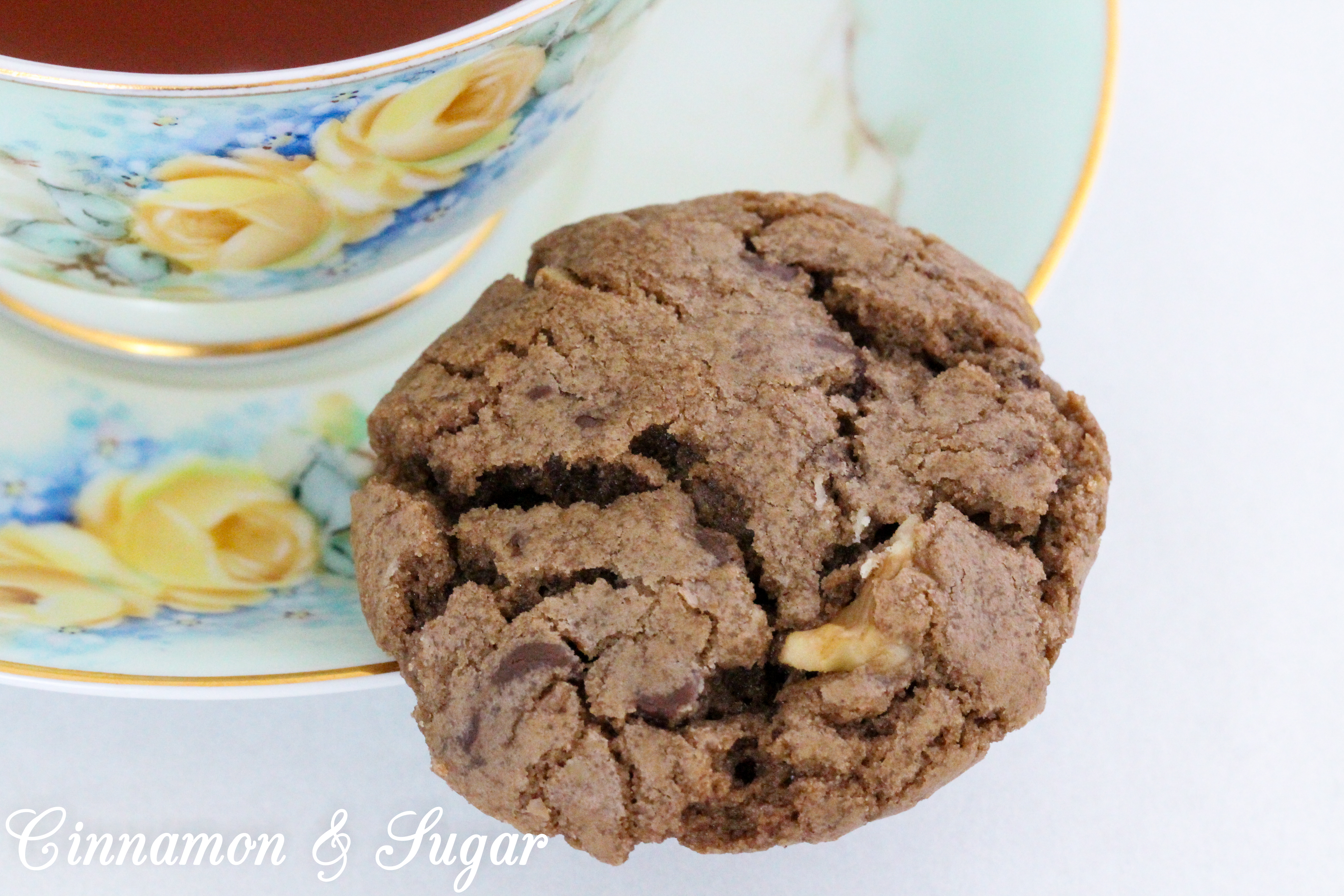 Chocolate Walnut Cookies are the perfect combination of chewy and crunchy, thanks to the melted chocolate, chocolate chips, and walnuts. Recipe shared with permission granted by Debra Sennefelder, author of Three Widows and a Corpse.
