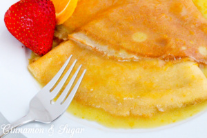 Crêpes Suzette are a few staple ingredients whisked together and paired with a few simple ingredients simmered together, creating a scrumptious treat Recipe shared with permission granted by Maya Corrigan, author of CRYPT SUZETTE.