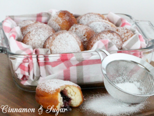 Jelly-filled donuts are yeasty deep-fried treats, stuffed with fruity jam and dusted with confectioner's sugar. Perfect for breakfast and coffee breaks! Recipe shared with permission granted by Ginger Bolton, author of Jealousy Filled Donuts.