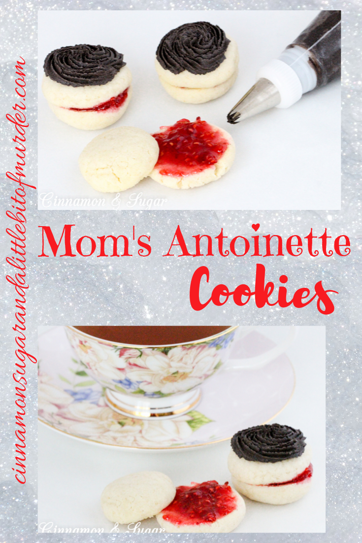 Mom's Antoinettes are buttery, almond-flavored shortbread-style cookies that are sandwiched around raspberry jam and topped with dark chocolate buttercream. Recipe shared with permission granted by Ellie Alexander, author of A CUP OF HOLIDAY FEAR.