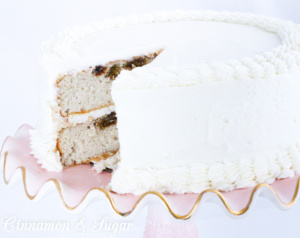 Rum Raisin Cake with Rum Buttercream starts with a cake mix, including lots of rum and is a deliciously light cake that will impress dessert lovers! Recipe shared with permission granted by Ellen Byron, author of FATAL CAJUN FESTIVAL.