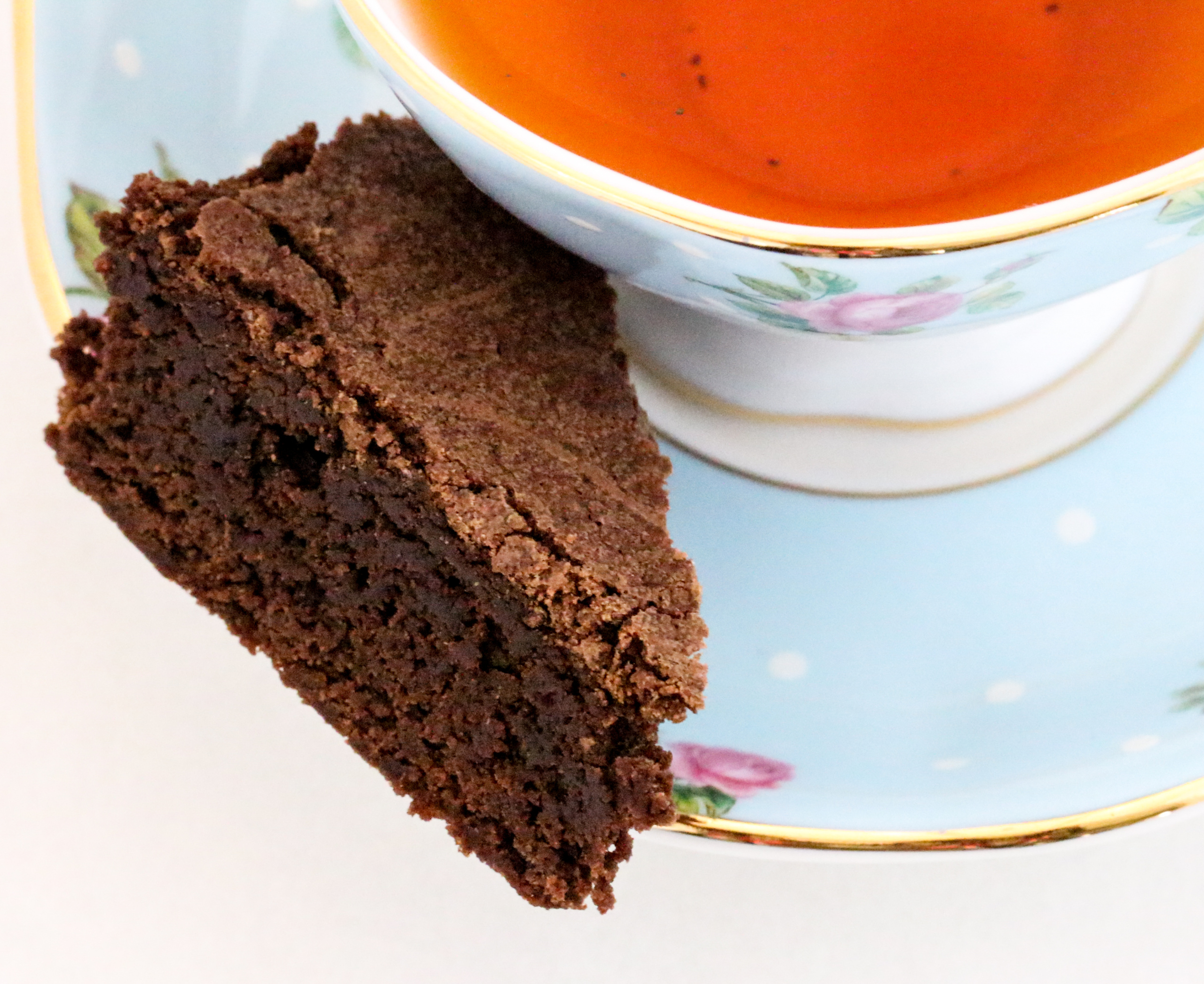 Rich and thick, almost like fudge, Olga's Brownies are scrumptious treats that will satisfy the most avid chocoholic! And cleanup is a breeze since the recipe uses only 1 saucepan to whisk the ingredients together. Recipe shared with permission granted by Barbara Ross, author of SEALED OFF.