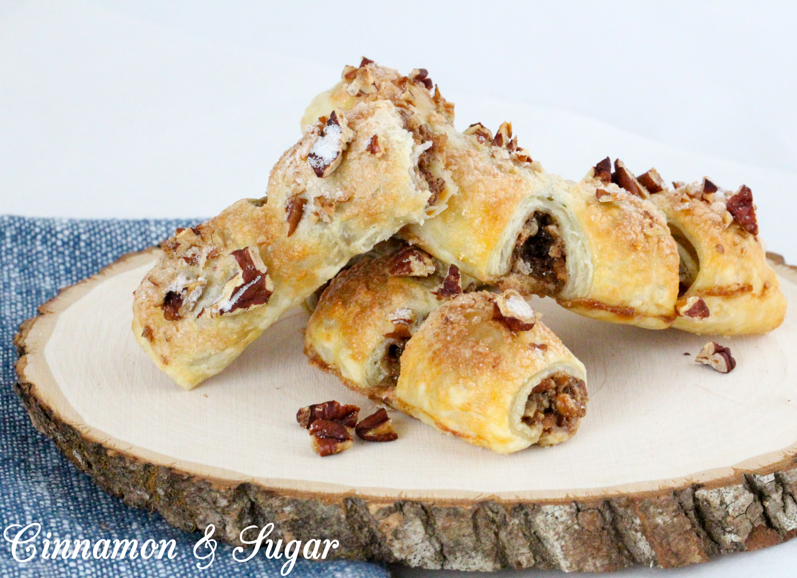 With crunchy, buttery pecans, an ample amount of cinnamon, and pre-made puff pastry, these Bear Claws are a tasty and easy addition to any breakfast, brunch, or coffee break! Recipe shared with permission granted by Maddie Day, author of MURDER AT THE TAFFY SHOP.
