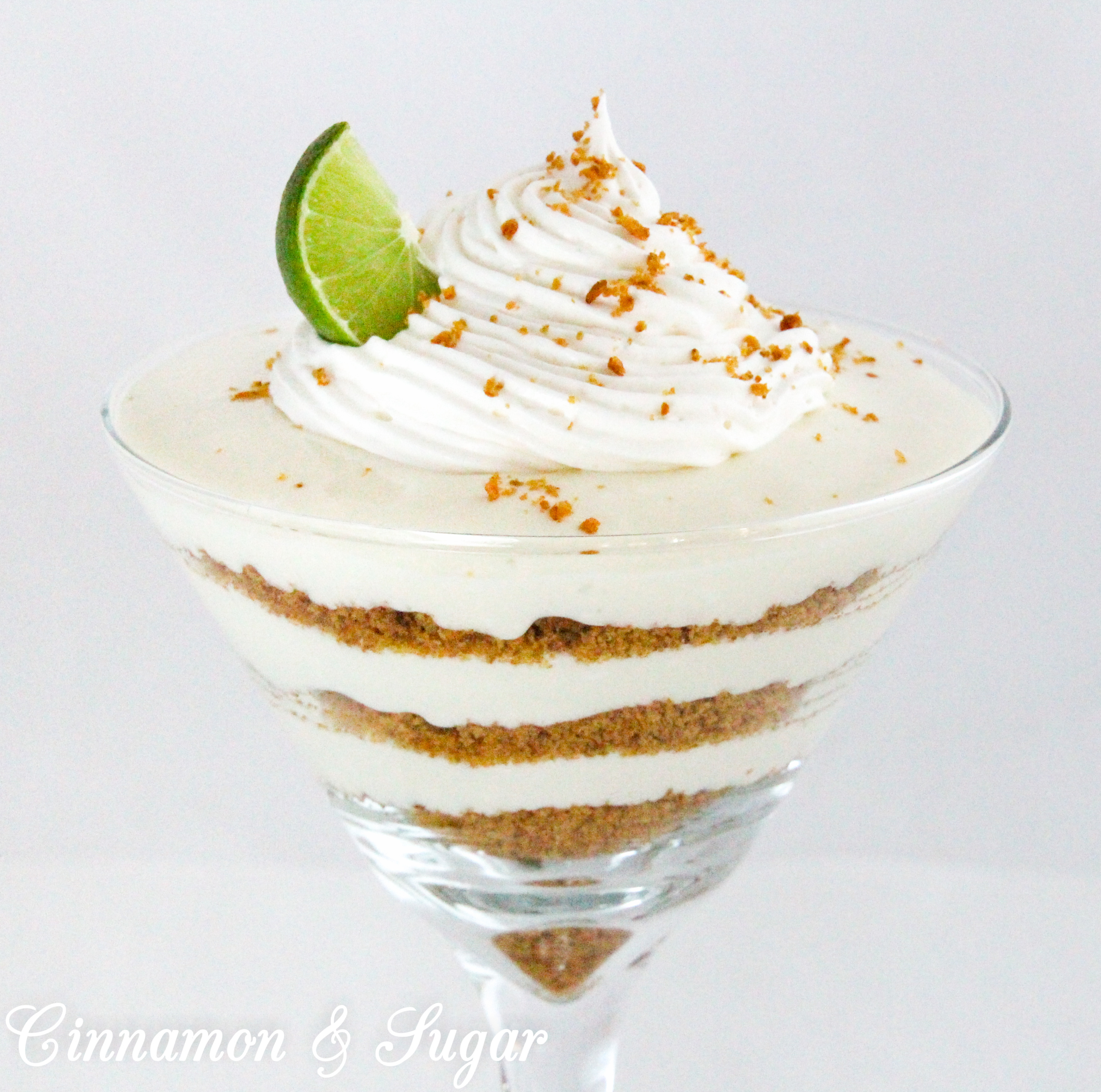 Key Lime Parfait combines tart citrus key limes with creamy whipped cream. Layered with crunchy, sweet graham cracker crumbs this dessert makes for an elegant presentation. Recipe shared with permission granted by Lucy Burdette, author of THE KEY LIME CRIME.