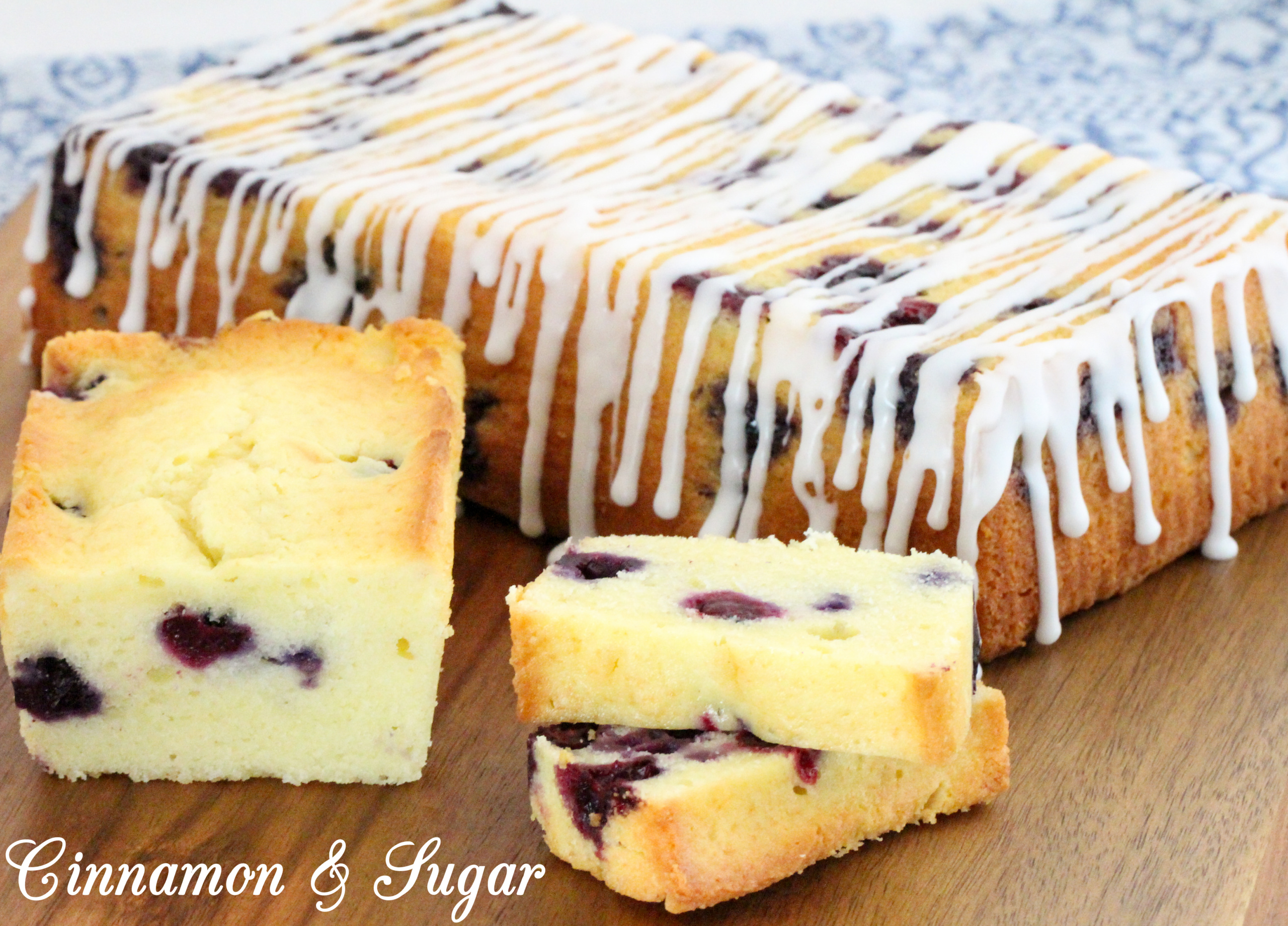 Blueberry Cream Cheese Bread is loaded with plump, fresh blueberries and tangy cream cheese, making this a supremely moist and flavorful treat! Recipe shared with permission granted by Lee Hollis, author of DEATH OF A BLUEBERRY TART.