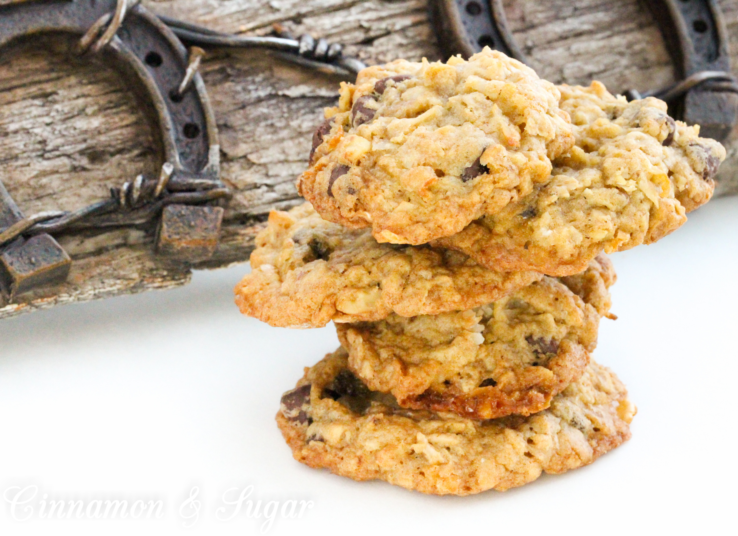 Cowgirl Cookies are the riff to Cowboy Cookies for a little girl's party. Brown sugar based cookie dough is stuffed full of oats, chocolate chips, coconut, marshmallows, and walnuts for a substantial mouthwatering cookie. Recipe from cozy mystery SPRINKLES OF SUSPICION by Kim Davis.