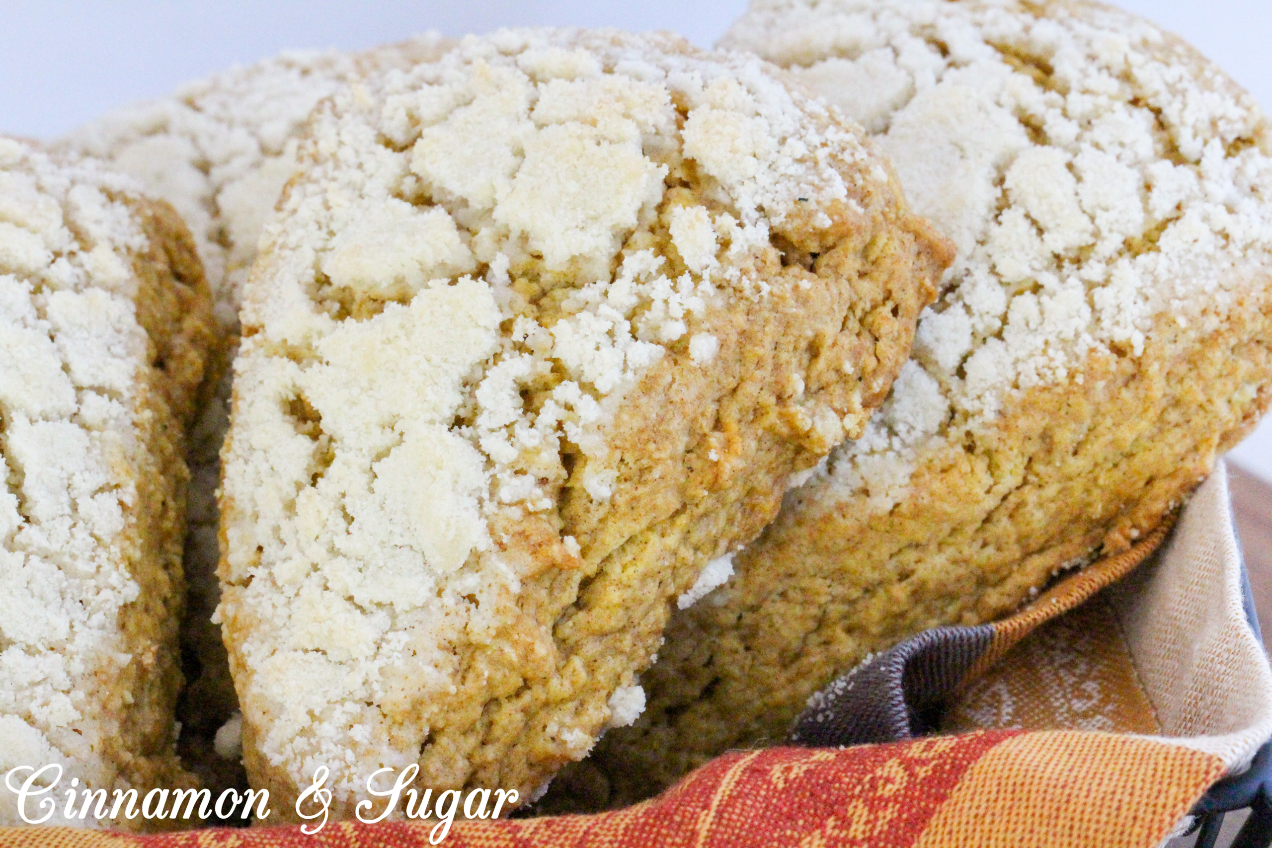 Sweet streusel complements the cinnamon in these Maple-Pumpkin Scones without being overly crumbly. Mild pumpkin brings color and a moist texture to these tea time treats. Recipe shared with permission granted by Kate Carlisle, author of THE GRIM READER.