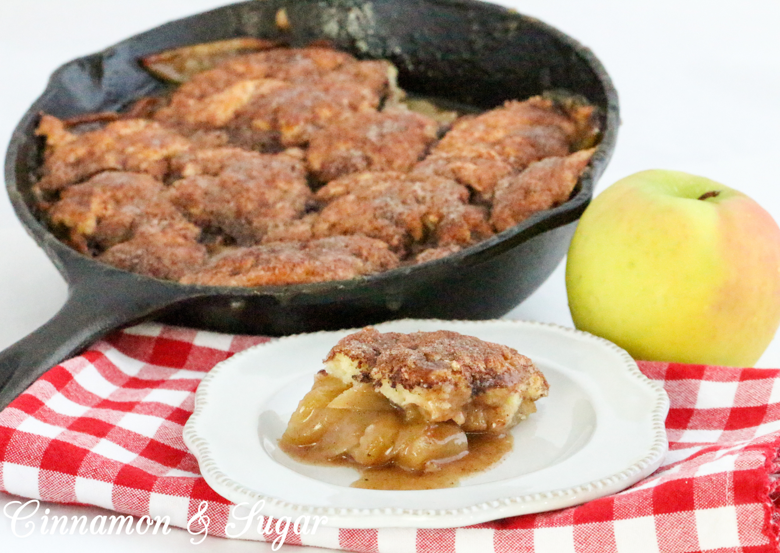While rustic, Dutch Apple Cobbler in a Cast-Iron Skillet is scrumptiously delicious from the cinnamon-y tender apples to the buttery cinnamon sugar crunch coating the rich, biscuit-like topping. Recipe shared with permission granted by Cheryl Hollon, author of STILL KNIFE PAINTING.