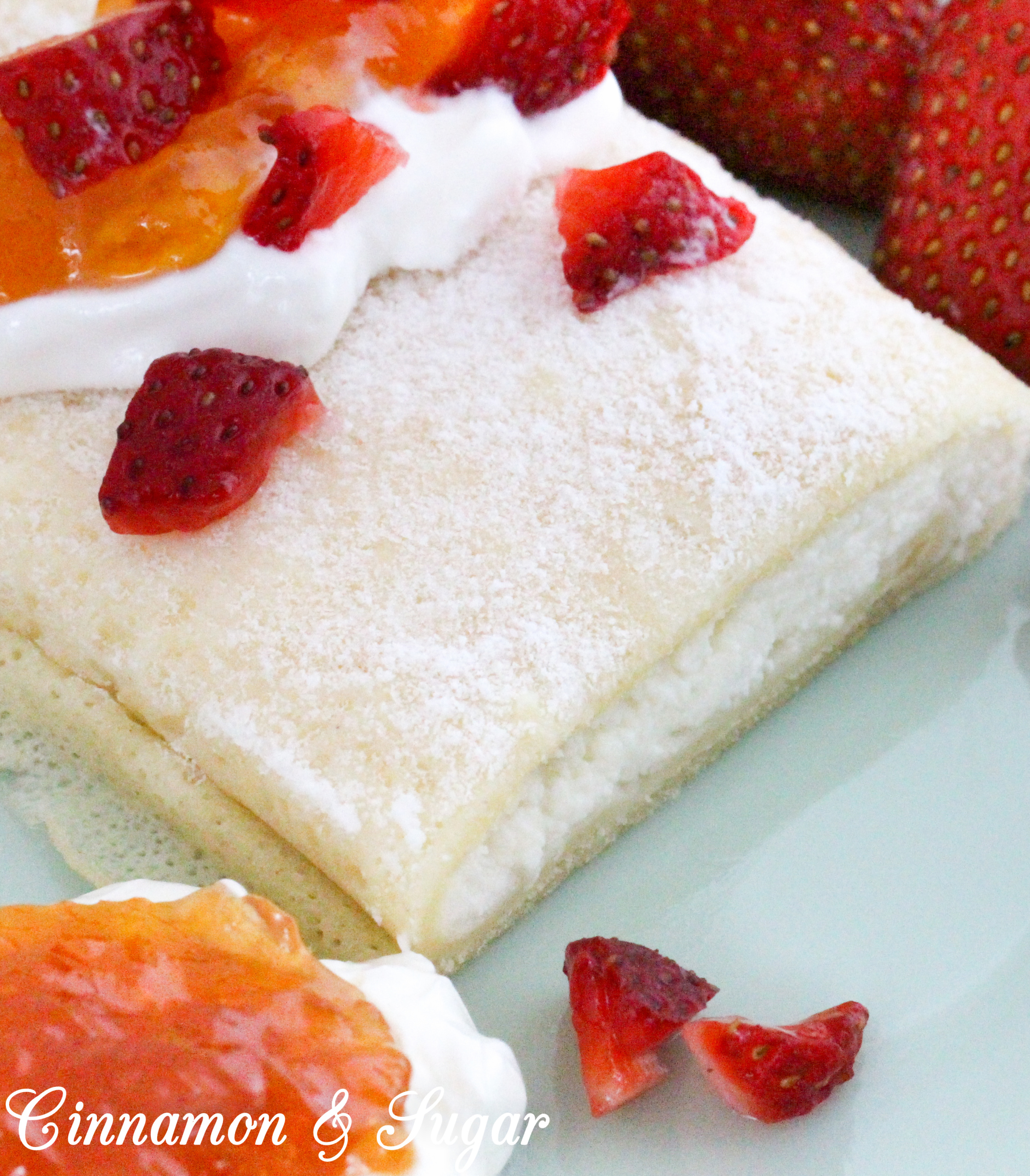 A traditional Hungarian dish, Juliana's Palacsinta are sweet cheese-filled crepes and baked with a light sprinkle of powdered sugar after filling. Garnish with sour cream, fresh strawberries, and jam for a delicious brunch or a breakfast-themed dinner. Recipe shared with permission granted by Julia Buckley, author of DEATH OF A WANDERING WOLF.