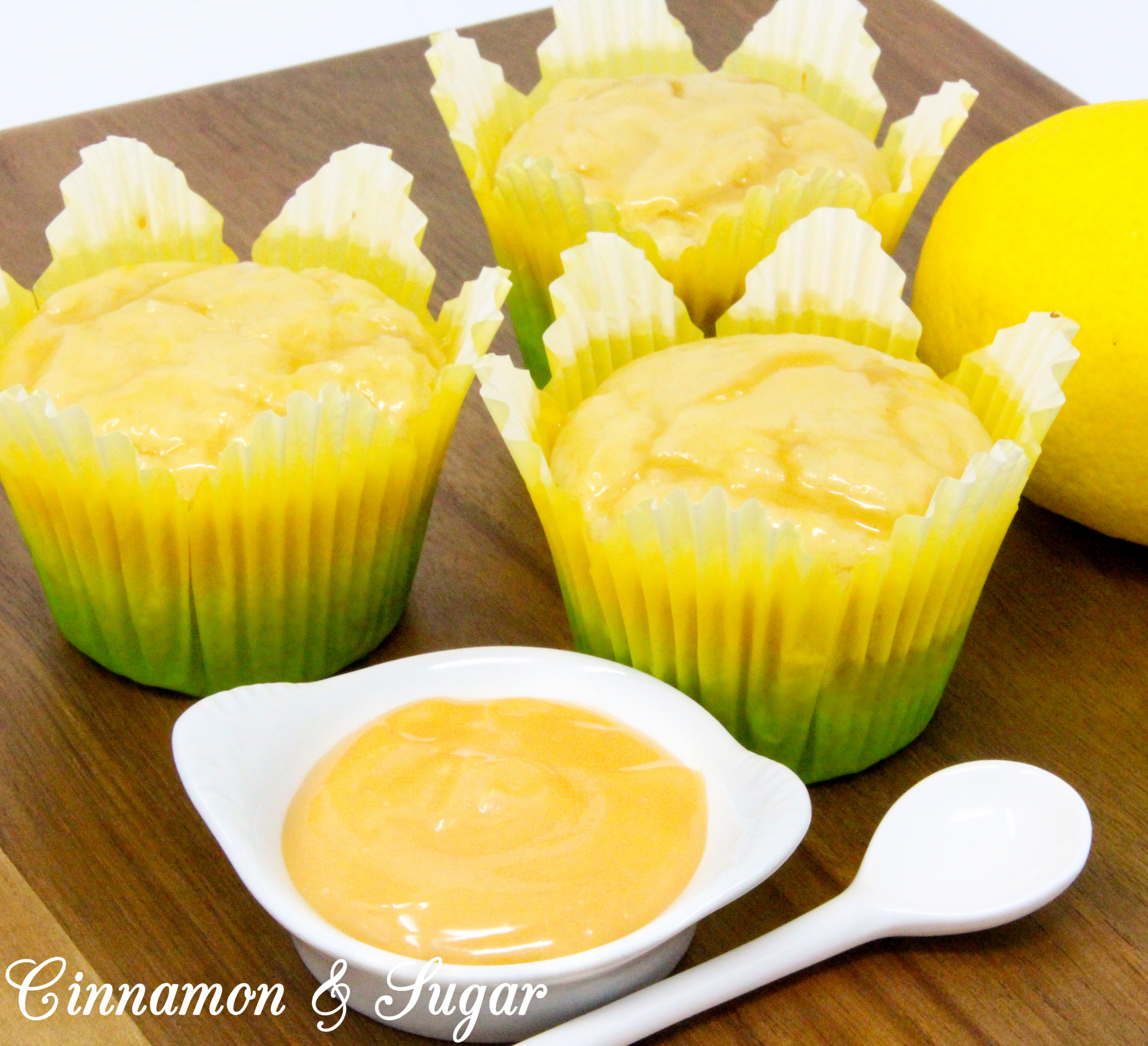Lemon Curd Muffins are super moist and ultra flavorful thanks to the generous amounts of lemon zest, lemon juice, and lemon curd! A delicious treat for breakfast and snack time, or serve with a dollop of ice cream for dessert. Recipe shared with permission granted by Libby Klein, author of WINE TASTINGS ARE MURDER.