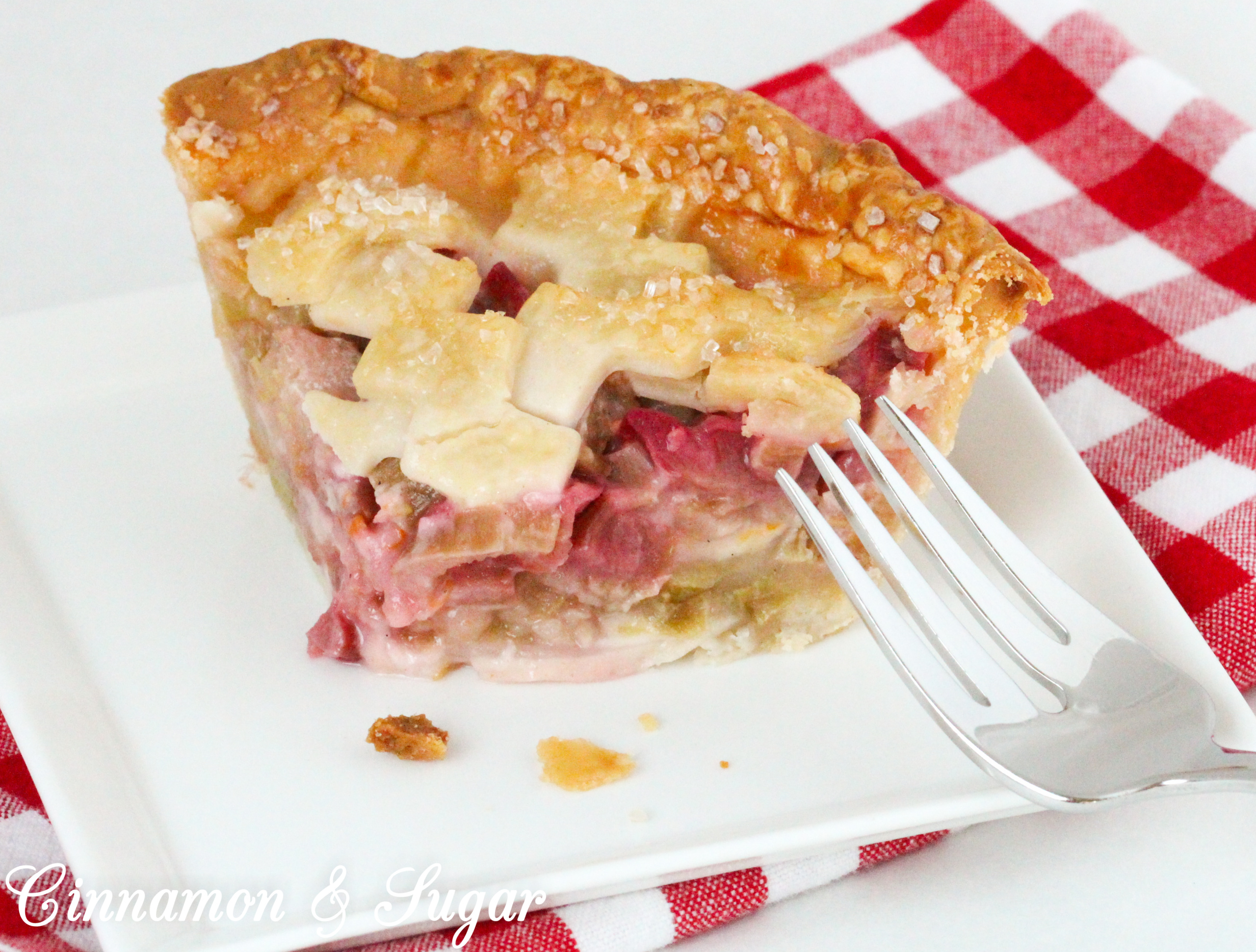 Juicy and sweet/tart, the pretty and delicious pink rhubarb filling and flaky crust make these mini rhubarb pies a delicious ending to any meal. Recipe shared with permission granted by Tracy Gardner, author of BEHIND THE FRAME.